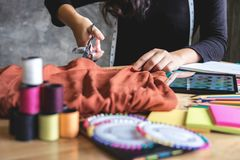 Young woman dressmaker or designer working as fashion designers. Measure and Cutting for clothes, profession and job occupation, Fashion Designer Stylish royalty free stock photos