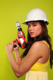 Young Woman With Drill Royalty Free Stock Photo