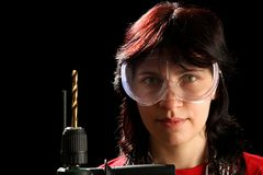 Young woman with drill Stock Images