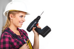 Young woman with a drill Royalty Free Stock Photo