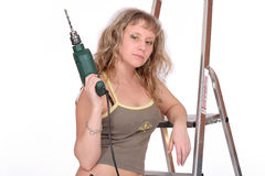 Young woman with a drill on st. Epladder. white background Stock Images