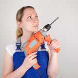 Young woman with drilling machine in her hands Stock Photos