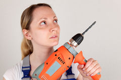 Young woman with drilling machine Stock Image