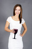 Young woman with drink Royalty Free Stock Photos