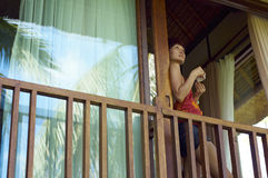 Young woman drink coffee on balcony Stock Photography