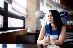 Young woman drink coffee Royalty Free Stock Images