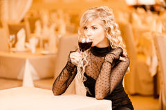 Young woman drink red wine Stock Image