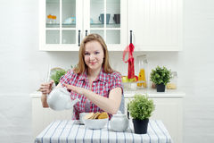 Young woman drink tea. In kitchen Stock Photo