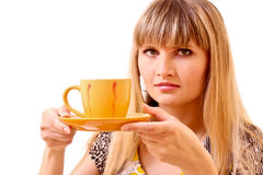 Young woman drink tea from cup isolated Royalty Free Stock Images