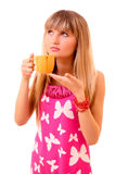 Young woman drink tea from cup isolated Stock Photo