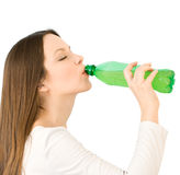 Young woman drink a water from bottle Royalty Free Stock Photography