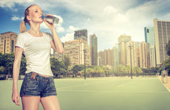 Young woman drink water Royalty Free Stock Photos