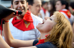 Young woman drink wine, San Fermin Stock Images