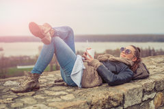 Young woman drinkig coffe on the fortress Royalty Free Stock Photo