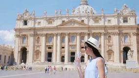 Young woman drinkinf water background at St. Peter's Basilica church in Vatican city, Rome, Italy. The St. Peter's. Happy tourist in Rome over St. Peter's stock video