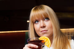 Young woman drinking alone in the club Stock Photo