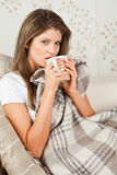 Young woman drinking in the bed Stock Photo
