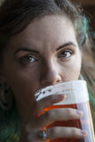 Young Woman Drinking Beer Royalty Free Stock Images
