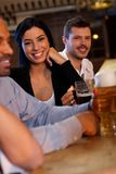 Young woman drinking beer in pub Royalty Free Stock Images