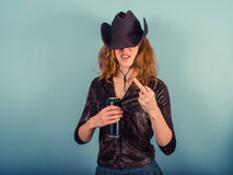 Young woman drinking and being rude Stock Photography