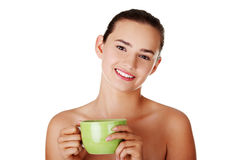 Young woman drinking  from big mug Stock Image