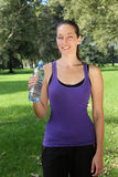 Young woman with drinking bottle during sports or jogging Royalty Free Stock Photography