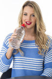 Young Woman Drinking Bottle of Still Mineral Water Stock Photo
