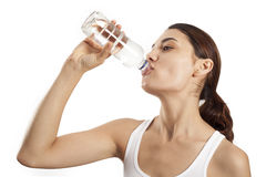 Young woman drinking bottle of water Royalty Free Stock Photos