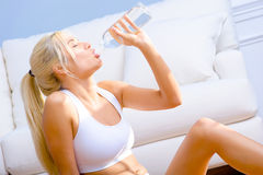 Young Woman Drinking Bottled Water Royalty Free Stock Image
