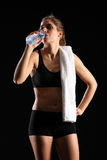 Young woman drinking bottled water after exercise Stock Images