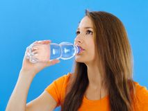 Young woman drinking bottled water Royalty Free Stock Photos