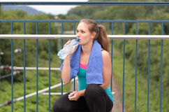 Young woman drinking bottled water Stock Photo