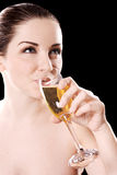 Young woman drinking champagne Royalty Free Stock Photo
