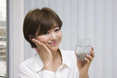 Young woman drinking chia seeds royalty free stock photo
