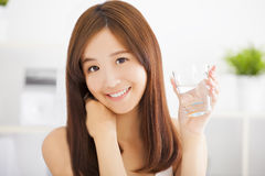 Young  woman drinking clean water Royalty Free Stock Images