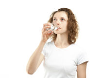 Young woman drinking clear water Royalty Free Stock Images