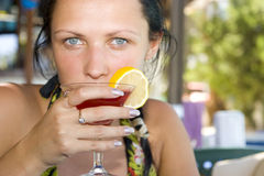 Young woman drinking cocktail Royalty Free Stock Images