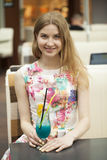 Young woman drinking cocktail in a cafe Royalty Free Stock Images