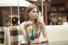 Young woman drinking cocktail in a cafe Royalty Free Stock Photography