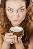 Young woman drinking coconut milk Royalty Free Stock Photos