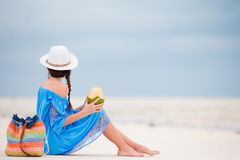 Young woman drinking coconut milk during tropical vacation Stock Image