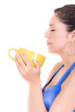 Young woman drinking cofee portrait. Royalty Free Stock Image