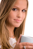 Young woman drinking coffe Stock Images
