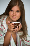 Young woman drinking coffe Royalty Free Stock Photography