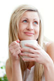 Young woman drinking a coffee Stock Image