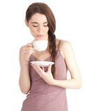 Young woman drinking coffee Royalty Free Stock Photography
