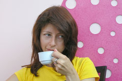 Young woman drinking coffee. In cafe Stock Photography