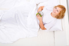 Young woman drinking coffee in Bed Royalty Free Stock Photo