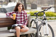 Young woman drinking coffee on a bicycle trip Royalty Free Stock Photography