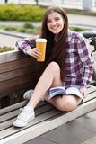 Young woman drinking coffee on a bicycle trip Stock Photo
